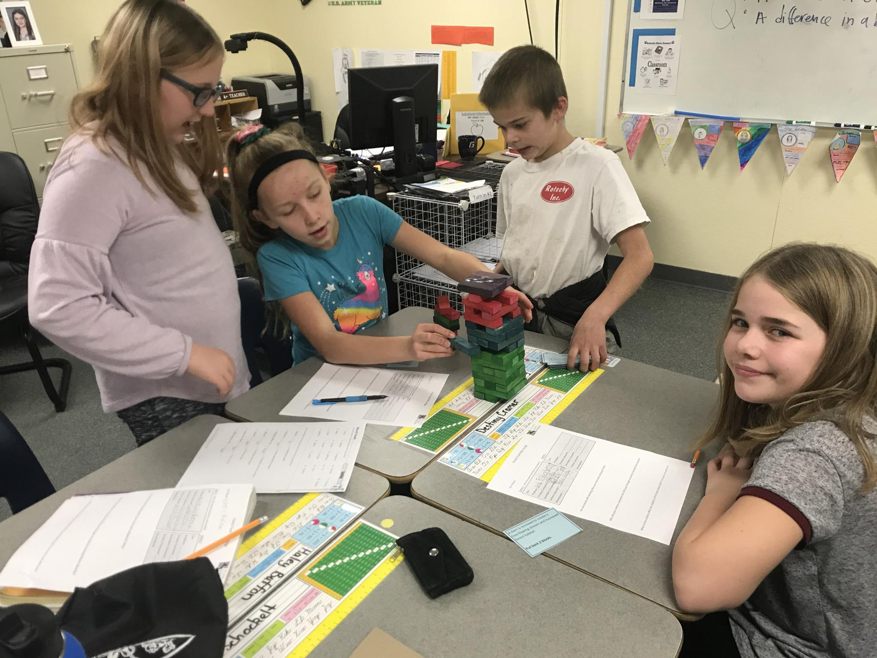 Four students collaborate on a science activity